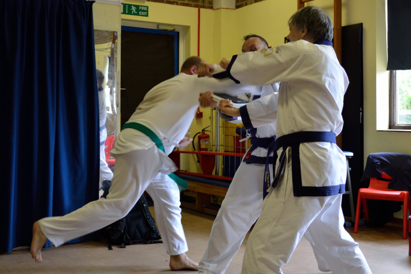 breaking board with elbow strike