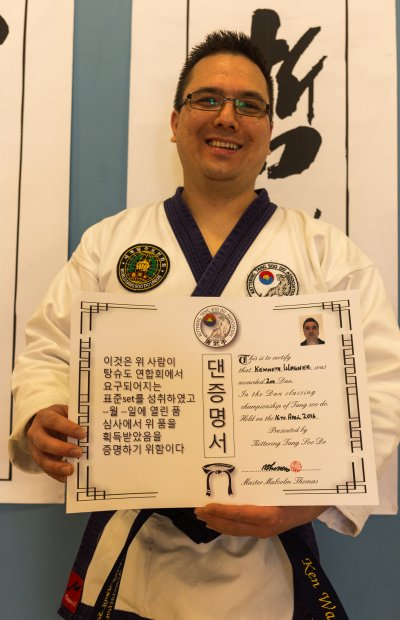Portrait of second dan with certificate